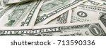 many dollar bills lie on the... | Shutterstock . vector #713590336