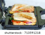 sandwich toaster with toast and ... | Shutterstock . vector #713591218