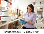 mature female customer looking... | Shutterstock . vector #713594704