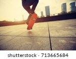 woman skateboarder... | Shutterstock . vector #713665684