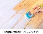 hand holding paint brush and... | Shutterstock . vector #713670544