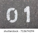 number one  painted on asphalt | Shutterstock . vector #713674294