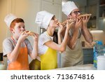 the young happy family in cook... | Shutterstock . vector #713674816