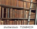 old vintage books on wooden... | Shutterstock . vector #713684224