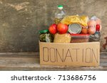 donation box with food.  | Shutterstock . vector #713686756