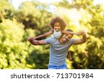 portrait of young father... | Shutterstock . vector #713701984
