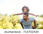 portrait of young father... | Shutterstock . vector #713702434