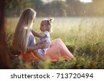 warm portrait of mother and... | Shutterstock . vector #713720494