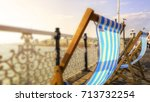 deck chairs billowing in breeze ... | Shutterstock . vector #713732254