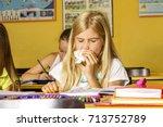 a cold girl in school | Shutterstock . vector #713752789