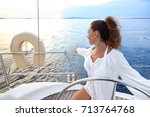 attractive woman enjoy sailing... | Shutterstock . vector #713764768