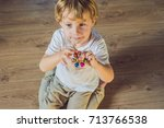 young boy play with fidget... | Shutterstock . vector #713766538