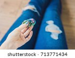 girl teenager in holey jeans... | Shutterstock . vector #713771434