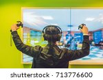 young man playing video games... | Shutterstock . vector #713776600