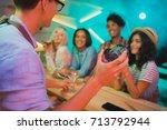 selective focus of barman... | Shutterstock . vector #713792944