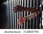 hands of prisoner in jail as... | Shutterstock . vector #713805790