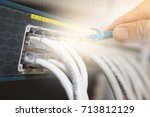 switch and ethernet cables with ... | Shutterstock . vector #713812129