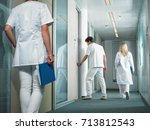 male doctor opening door in a... | Shutterstock . vector #713812543