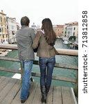 Small photo of Rear view of couple on Academia Bridge.