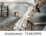 conveyor line carrying aluminum ... | Shutterstock . vector #713815990