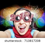 young woman in glasses in the... | Shutterstock . vector #713817208
