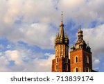 Small photo of KRAKOW, POLAND – AUGUST 24, 2017: The steeples of the church of St. Mary rises above the clouds by Valerie Rise