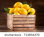 fresh lemons with leaves in a... | Shutterstock . vector #713856370
