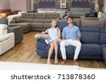 positive family couple choosing ... | Shutterstock . vector #713878360