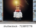 forklift moving white sugar... | Shutterstock . vector #713895778