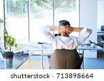 businessman at the desk in his... | Shutterstock . vector #713898664