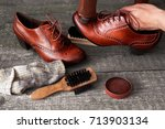 shoemaker applying shoe shiner... | Shutterstock . vector #713903134