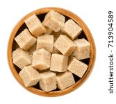 demerara brown sugar cubes in... | Shutterstock . vector #713904589
