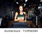 young fitness woman doing... | Shutterstock . vector #713906584