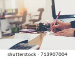 Small photo of Businessmen are writing business accounting results in a account book,Business concept