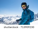cheerful skier looking at... | Shutterstock . vector #713909230