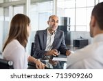 mature financial agent showing... | Shutterstock . vector #713909260