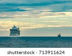 white cruise liner moving to... | Shutterstock . vector #713911624