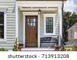 inviting front porch with a... | Shutterstock . vector #713913208