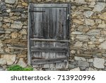old wall from a ruin of a... | Shutterstock . vector #713920996