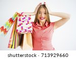 pretty girl with shopping bags | Shutterstock . vector #713929660