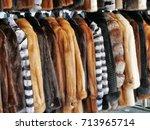 luxury fur coats hanging on... | Shutterstock . vector #713965714