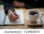 business woman writing on... | Shutterstock . vector #713983474