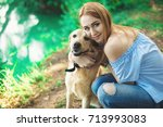 portrait of woman with dog | Shutterstock . vector #713993083