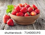 strawberry on a old wooden... | Shutterstock . vector #714000193