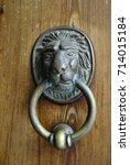 vintage door handle on a wooden ... | Shutterstock . vector #714015184