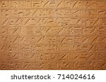 egyptian hieroglyphs on the wall | Shutterstock . vector #714024616