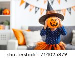 Stock photo happy laughing child girl in witch costume to halloween 714025879