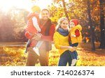 happy family mother  father and ... | Shutterstock . vector #714026374