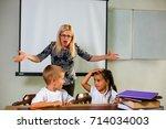 the teacher scolds the children'... | Shutterstock . vector #714034003
