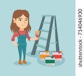 caucasian house painter holding ...   Shutterstock .eps vector #714046930